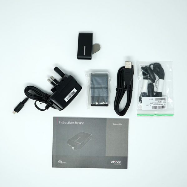 Image of Oticon Phone Clip 1 product on white background with manual and cables