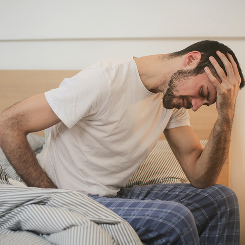 man suffering before bed